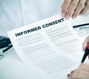 Person signing an informed consent form. Image: nito/shutterstock.com