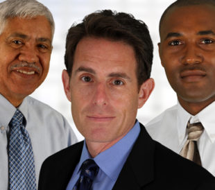 Business team of mixed races at office. Image: Rob Marmion/Shutterstock.com.