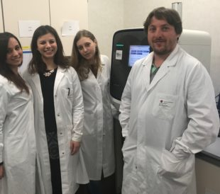 Dr.D'Alessandra and his team stand in their lab. Image © Dr. Yuri D'Alessandra 2018