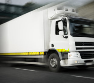 Refrigerated truck in motion. Image: Rihardzz/Shutterstock.com