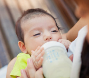 Baby with milk formula
