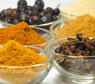 Bowls of colorful spices, which are commonly used in food fraud.